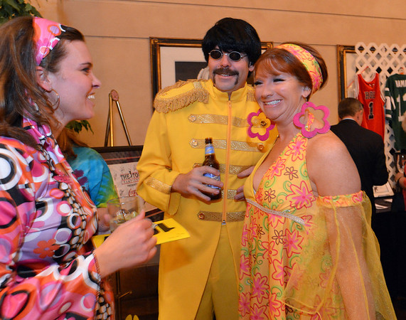 "Greg and Critsy Jones during the 48th annual Bal Swan Ball with the 1960's theme of ""Peace, Love and Bal Swan"" at the Omni Interlocken Hotel Resort on Saturday.<br /> March 2, 2013<br /> staff photo/ David R. Jennings"