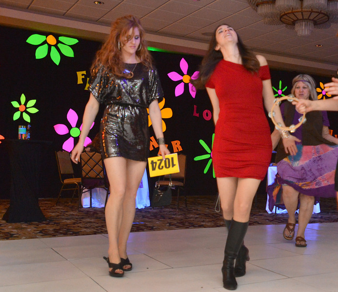 "Mindy Barber, left, and Erin Boyle dance during the 48th annual Bal Swan Ball with the 1960's theme of ""Peace, Love and Bal Swan"" at the Omni Interlocken Hotel Resort on Saturday.<br /> March 2, 2013<br /> staff photo/ David R. Jennings"