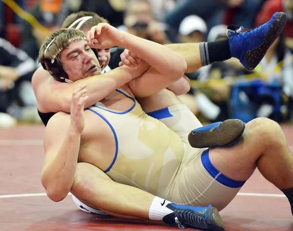Broomfield's Connor Eakes wrestles Pueblo South's Hunter Reinert in the 220 pound weight class in the championship match at Centaurus High  on Saturday.<br /> January 26, 2013<br /> staff photo/ David R. Jennings