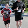 Fred Nelson, right, runs with his grandson David Nelson, 9, during the Kohl Elementary School 5k fun run fundraiser for the school on Saturday.<br /> April 30, 2011<br /> staff photo/David R. Jennings