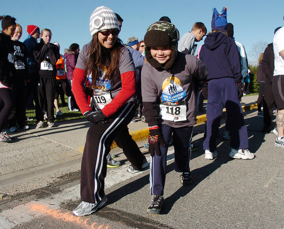 Lupe Hirt, left, stretches at the start line with her son andrew, 6, during the Kohl Elementary School 5k fun run fundraiser for the school on Saturday.<br /> April 30, 2011<br /> staff photo/David R. Jennings