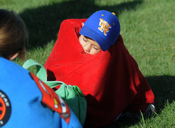 Javin Scholz, 6, keeps warm in his blanket during the Kohl Elementary School 5k fun run fundraiser for the school on Saturday.<br /> April 30, 2011<br /> staff photo/David R. Jennings