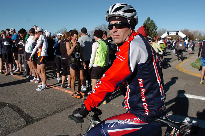 Scott Sutton prepares to lead the runners through the course on his bicycle during the Kohl Elementary School 5k fun run fundraiser for the school on Saturday.<br /> April 30, 2011<br /> staff photo/David R. Jennings
