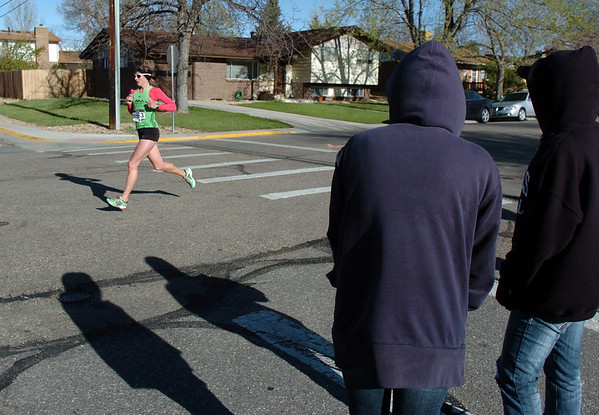 Lori Walker, the first woman runner to finish, runs past people watching the Kohl Elementary School 5k fun run fundraiser for the school's gym floor on Saturday.<br /> April 30, 2011<br /> staff photo/David R. Jennings