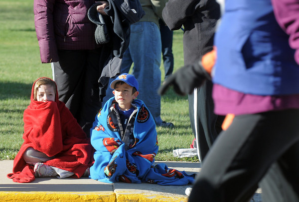 Brittany Scholz, 8, left and her brother Javin, 6, watch the runners and walkers begin the Kohl Elementary School 5k fun run fundraiser for the school on Saturday.<br /> April 30, 2011<br /> staff photo/David R. Jennings