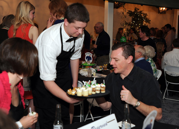 Pro Start student Ty Garner, left, shows Derek Tuz desserts during the 3rd annual Eagle Sports Gala for Broomfield High School Athletics at the Church Ranch Event Center on Friday.<br /> March 16,  2012 <br /> staff photo/ David R. Jennings