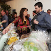 Melissa Albert , left, checks out a basket with Kevin Nash for the silent auction during the 3rd annual Eagle Sports Gala for Broomfield High School Athletics at the Church Ranch Event Center on Friday.<br /> March 16,  2012 <br /> staff photo/ David R. Jennings