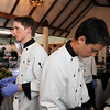 Pro Start students Nick Welsh, left, and Isaac Wilson prepare to serve food to participants of the 3rd annual Eagle Sports Gala for Broomfield High School Athletics at the Church Ranch Event Center on Friday.<br /> March 16,  2012 <br /> staff photo/ David R. Jennings