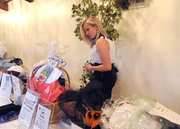 Nicole Jones looks at items in the silent auction during the 3rd annual Eagle Sports Gala for Broomfield High School Athletics at the Church Ranch Event Center on Friday.<br /> March 16,  2012 <br /> staff photo/ David R. Jennings