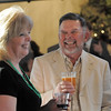 Broomfeild High principal  Ginger Ramsey, left,  shares a laugh with John Ferraro during the 3rd annual Eagle Sports Gala for Broomfield High School Athletics at the Church Ranch Event Center on Friday.<br /> March 16,  2012 <br /> staff photo/ David R. Jennings