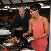 Michael and Jacqueline Rowe select food prepared by the Pro Start students during the 3rd annual Eagle Sports Gala for Broomfield High School Athletics at the Church Ranch Event Center on Friday.<br /> March 16,  2012 <br /> staff photo/ David R. Jennings