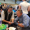 Magician Richard Nakata, left, shows Steve Wood a card trick during the 3rd annual Eagle Sports Gala for Broomfield High School Athletics at the Church Ranch Event Center on Friday.<br /> March 16,  2012 <br /> staff photo/ David R. Jennings