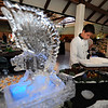 The Eagle ice sculpture is the center piece to the Pro Start food table with Isaac Wilson makeing final perparations during the 3rd annual Eagle Sports Gala for Broomfield High School Athletics at the Church Ranch Event Center on Friday.<br /> March 16,  2012 <br /> staff photo/ David R. Jennings