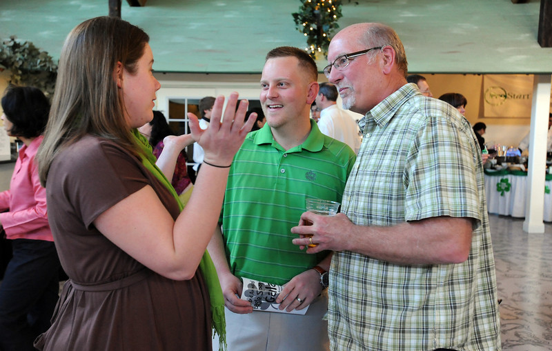 Emily Bosio, left, chats with her husband Andrew and Charlie Belton during the 3rd annual Eagle Sports Gala for Broomfield High School Athletics at the Church Ranch Event Center on Friday.<br /> March 16,  2012 <br /> staff photo/ David R. Jennings