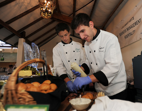 Pro Start students Farid Srouji, right, and Isaac Wilson prepare Beef Siders for participants in the 3rd annual Eagle Sports Gala for Broomfield High School Athletics at the Church Ranch Event Center on Friday.<br /> March 16,  2012 <br /> staff photo/ David R. Jennings