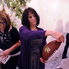Deanne Davies looks at an autographed football while Cyndy Benschop, left, looks at other items for the silent auction during the 3rd annual Eagle Sports Gala for Broomfield High School Athletics at the Church Ranch Event Center on Friday.<br /> March 16,  2012 <br /> staff photo/ David R. Jennings