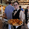 Pro Start student Lauren Kennedy travels the crowd offering appetizers during the 3rd annual Eagle Sports Gala for Broomfield High School Athletics at the Church Ranch Event Center on Friday.<br /> March 16,  2012 <br /> staff photo/ David R. Jennings