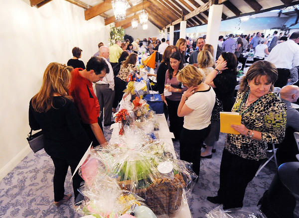 Attendees look at the numerous baskets for the silent auction during the 3rd annual Eagle Sports Gala for Broomfield High School Athletics at the Church Ranch Event Center on Friday.<br /> March 16,  2012 <br /> staff photo/ David R. Jennings