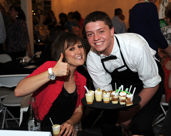 Kelsey Saunders, left, gives the thumbs up with pro Start student Ty Garner serving desserts  during the 3rd annual Eagle Sports Gala for Broomfield High School Athletics at the Church Ranch Event Center on Friday.<br /> March 16,  2012 <br /> staff photo/ David R. Jennings