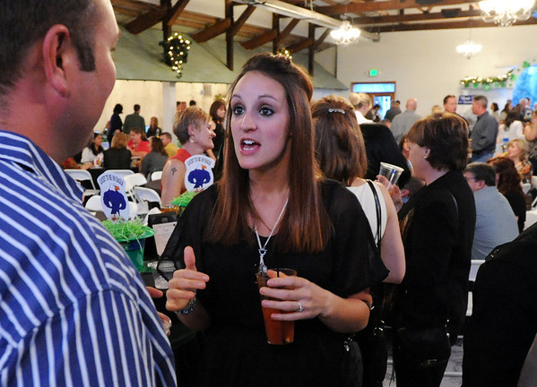 Liz Davies, right, chats during the 3rd annual Eagle Sports Gala for Broomfield High School Athletics at the Church Ranch Event Center on Friday.<br /> March 16,  2012 <br /> staff photo/ David R. Jennings