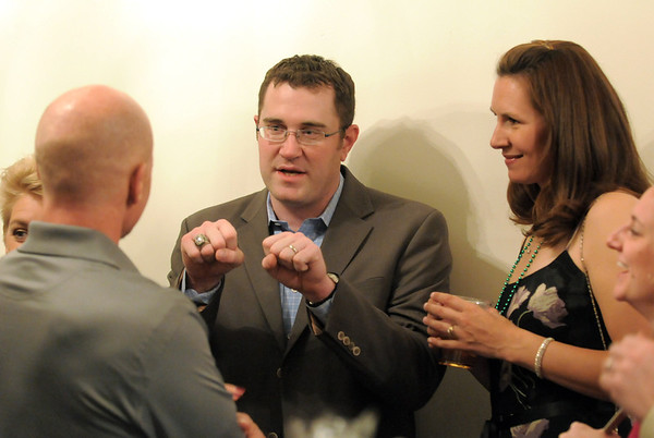 Head basketball coach Terrence Dunn, center and his wife Jennifer chat with attendees during the 3rd annual Eagle Sports Gala for Broomfield High School Athletics at the Church Ranch Event Center on Friday.<br /> March 16,  2012 <br /> staff photo/ David R. Jennings