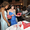 Angela Finan, left, and Sandy Ry look at auction items during the 45th Bal Swan Ball at the Omni Interlocken Resort on Saturday.<br /> <br /> March 6, 2010<br /> Staff photo/David R. Jennings