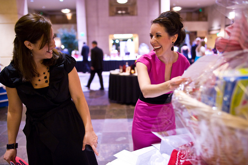 L-R: Chelsea Incorvaia and Shelly Brodie of Bal Swan look over some of the auction items at the Bal Swan fund raising ball on Saturday evening March 5th, 2010.<br /> <br /> Photo by: Jonathan Castner