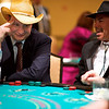 L-R: Zsolt Bessko, cq, of Jones and Keller and Randy Maes have fun at the card tables during Bal Swan fund raising ball on Saturday evening March 5th, 2010.<br /> <br /> Photo by: Jonathan Castner