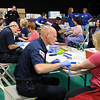 Members of North Metro Fire Rescue help draw blood during the 9Health Fair at Broomfield United Methodist Church on Saturday.<br /> <br /> April 21, 2012 <br /> staff photo/ David R. Jennings