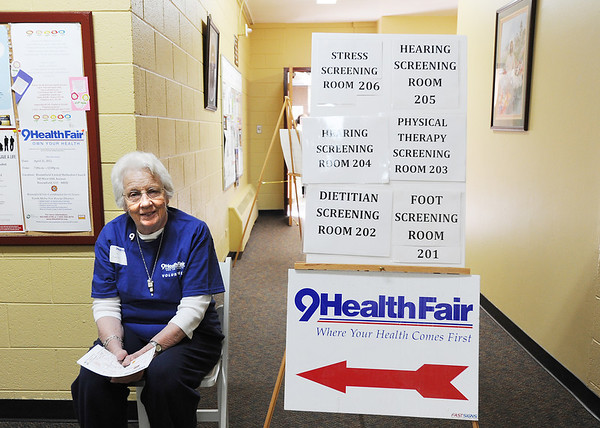 Volunteer Lila Bartel waits to guide participants to the correct rooms during the 9Health Fair at Broomfield United Methodist Church on Saturday.<br /> <br /> April 21, 2012 <br /> staff photo/ David R. Jennings