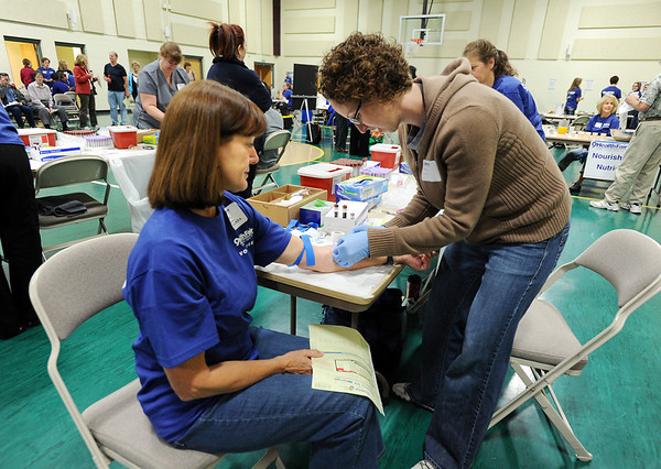 Diane Spencer-Herro, left, has her blood drawn  by Mackenzie Erickson during the 9Health Fair at Broomfield United Methodist Church on Saturday.<br /> <br /> April 21, 2012 <br /> staff photo/ David R. Jennings