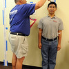 Kami Sherpa, right, has his height checked by volunteer Colin Johnson during the 9Health Fair at Broomfield United Methodist Church on Saturday.<br /> <br /> April 21, 2012 <br /> staff photo/ David R. Jennings