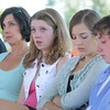 Cathy Faughnan Green, left,  with her children Juliet, 14, Siena, 17 and Liam, 12, as their husband and father Chris Faughnan, who died ion Sept. 11, 2001, during the 9/11 Commemorative Ceremony at the 9/11 Memorial in Community Park on Sunday.<br /> September 11, 2011<br /> staff photo/ David R. Jennings