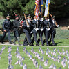 The Broomfield Police Honor Guard marches to the 9/11 Memorial for  the 9/11 Commemorative Ceremony at the in Community Park on Sunday.<br /> September 11, 2011<br /> staff photo/ David R. Jennings