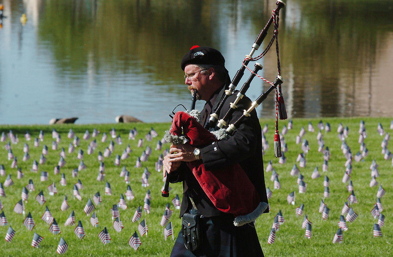 Bagpiper Mike Young rehearses playing while marching to the 9/11 Memorial for the 9/11 Commemorative Ceremony at the 9/11 Memorial in Community Park on Sunday.<br /> September 11, 2011<br /> staff photo/ David R. Jennings