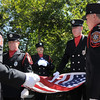 The North Metro Fire Rescue Honor Guard folds the U.S. Flag that flew over the 9/11 Memorial this last year during the 9/11 Commemorative Ceremony at the 9/11 Memorial in Community Park on Sunday.<br /> September 11, 2011<br /> staff photo/ David R. Jennings