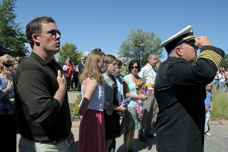 Michael Faughnan, left, with the family of his late brother, Chris, and North Metro Fire Rescue Chief Joe Bruce salute during the 9/11 Commemorative Ceremony at the 9/11 Memorial in Community Park<br /> September 11, 2011<br /> staff photo/ David R. Jennings