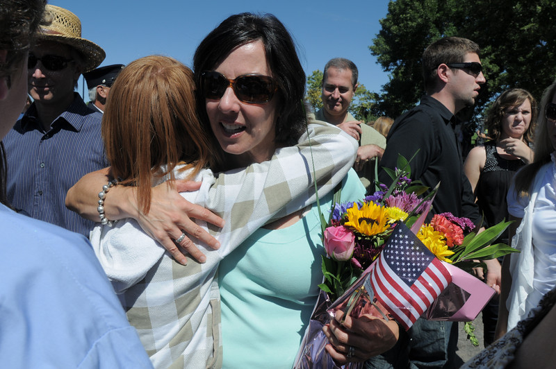 Cathy Faughnan Green is hugged by Kaelin Sleevi, 12, a Faughnan family member, after the 9/11 Commemorative Ceremony at the 9/11 Memorial in Community Park on Sunday.<br /> September 11, 2011<br /> staff photo/ David R. Jennings