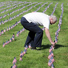 Tom Faughnan looks for the flag of his son Chris, who died in the World Trade Center attacks,  before the 9/11 Commemorative Ceremony at the 9/11 Memorial in Community Park on Sunday.<br /> September 11, 2011<br /> staff photo/ David R. Jennings