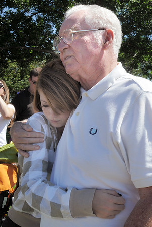 Tom Faughnan is hugged his grand daughter Kaelin Sleevi, 12, after releasing balloons in memory of Chris Faughnan, who died in the World Trade Center on Sept. 11, 2001, after the 9/11 Commemorative Ceremony at the 9/11 Memorial in Community Park on Sunday.<br /> September 11, 2011<br /> staff photo/ David R. Jennings