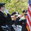Broomfeild Police officers salute during the 9/11 Commemorative Ceremony at the 9/11 Memorial in Community Park on Sunday.<br /> September 11, 2011<br /> staff photo/ David R. Jennings