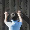 A boy touches the names of people who died in the World Trade Center listed on the 9/11 Memorial before the 9/11 Commemorative Ceremony at Community Park on Sunday.<br /> September 11, 2011<br /> staff photo/ David R. Jennings