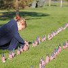 Baylee Bushlack, 7, looks at names on the falgs of the mini-healing field before the 9/11 Commemorative Ceremony at the 9/11 Memorial in Community Park on Sunday.<br /> September 11, 2011<br /> staff photo/ David R. Jennings
