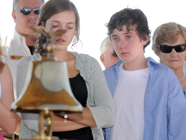 Siena Faughnan, 17,  and her brother Liam, 12, with their grandmother Joan, look at the fire bell afte it was rung to honor all who deid on Sept. 11 2001, during the 9/11 Commemorative Ceremony at the 9/11 Memorial in Community Park on Sunday.<br /> September 11, 2011<br /> staff photo/ David R. Jennings