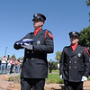 Lt, John Daugherty carries a U.S. flag to be presented to the Faughnan family during the 9/11 Commemorative Ceremony at the 9/11 Memorial in Community Park on Sunday.<br /> September 11, 2011<br /> staff photo/ David R. Jennings