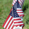 A flag for Chris Faughnan in the Mini-Healing Field for the 9/11 Commemorative Ceremony at the 9/11 Memorial in Community Park on Sunday.<br /> September 11, 2011<br /> staff photo/ David R. Jennings