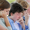 Liam Faughnan, 12, center, cries with his sisters and grand parents of Chris Faughnan, who died in the Sept. 11, 2001 atacks on the World Trade Center, cries during the 9/11 Commemorative Ceremony at the 9/11 Memorial in Community Park on Sunday.<br /> September 11, 2011<br /> staff photo/ David R. Jennings