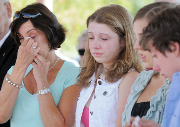 Cathy Faughnan Green, left, with her children Juilet Faughnan, 14, left, Siena, 17, and Liam, 12, cry as Chris Faughnan, who died in the World Trade Center attacks on Sept. 11, 2001, is remembered during the 9/11 Commemorative Ceremony at the 9/11 Memorial in Community Park on Sunday.<br /> September 11, 2011<br /> staff photo/ David R. Jennings
