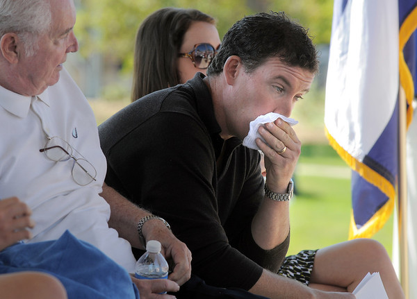 Michael Faughnan wipes away tears for his late brother Chris during the 9/11 Commemorative Ceremony at the 9/11 Memorial in Community Park on Sunday.<br /> September 11, 2011<br /> staff photo/ David R. Jennings