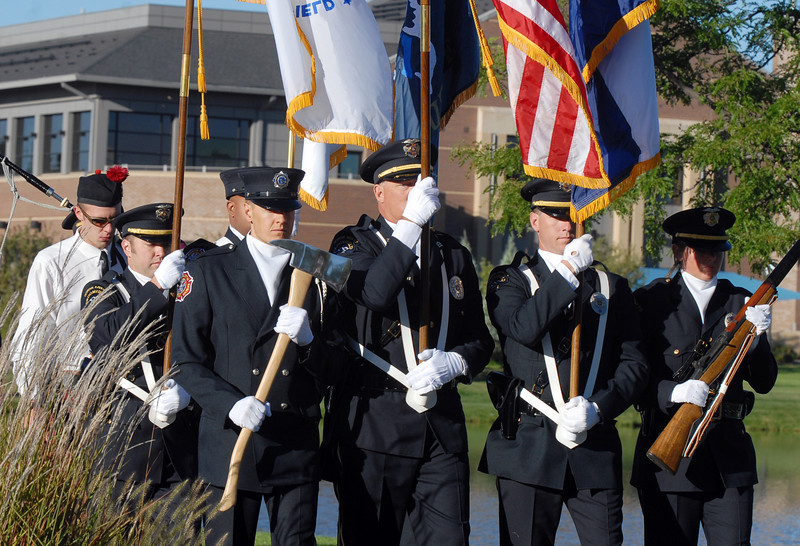 BE0919NINE19<br /> The combined Broomfield Police and North Metro Fire Honor Guard marches to the 9/11 ceremony at the 9/11 Memorial on Saturday.<br /> <br /> September 11, 2010<br /> staff photo/David R. Jennings